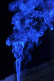 Blue smoke from aromas incense. Abstract background Stock Photo