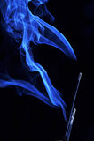 Blue smoke from aromas incense. Abstract background Royalty Free Stock Image