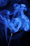 Blue smoke from aromas incense. Abstract background Stock Images