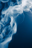 Blue smoke background. Artistic blue smoke background with copy-space Royalty Free Stock Images