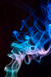 Blue smoke on black. Stock Photo