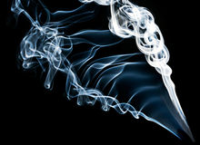 Blue smoke on black Stock Images
