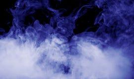 Blue smoke on the black background Stock Photos