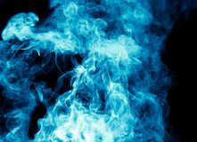 Blue smoke on black background Stock Photography