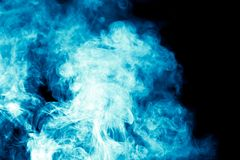 Blue smoke on black background Royalty Free Stock Images