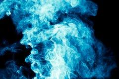 Blue smoke on black background Stock Photo