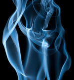 Blue smoke on black background Royalty Free Stock Image