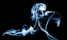 Blue Smoke. On black background Royalty Free Stock Photos