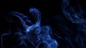 Blue smoke on black background stock video footage