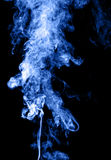 Blue smoke on black Stock Image