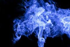 Blue smoke. On black background Royalty Free Stock Image