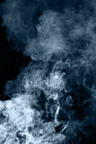 Blue smoke on a black background Stock Images