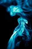Blue smoke on black background Stock Photos