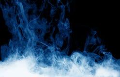 Blue smoke on the black background Royalty Free Stock Image