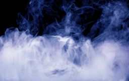 Blue smoke on the black background Stock Images
