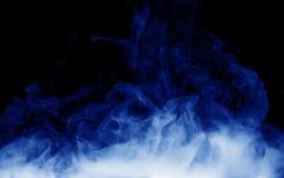 Blue smoke on the black background Stock Image