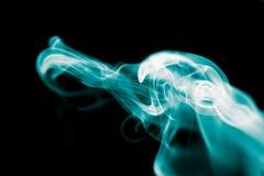 Blue smoke on black background Royalty Free Stock Image