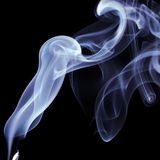 Blue Smoke on black background. Detail of Blue Smoke on black background Royalty Free Stock Photo