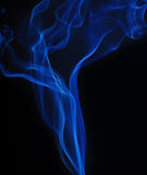 Blue smoke on black background Royalty Free Stock Photos