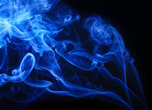 Blue smoke on black background Stock Photo