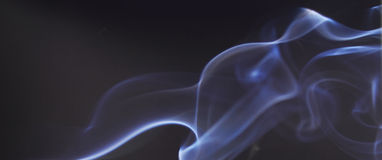 Blue smoke on black background Royalty Free Stock Images