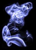 Blue smoke on a black background Stock Photo