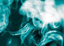 Blue smoke on black background Stock Image