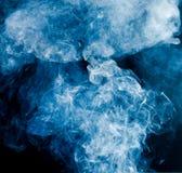 Blue smoke on a black background Stock Photos