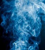 Blue smoke on a black background Royalty Free Stock Photo