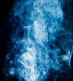 Blue smoke on a black background Stock Image