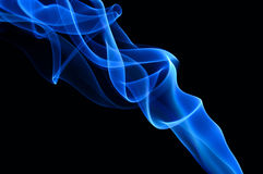 Blue smoke on the black background. Stock Photos