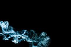Blue smoke on black background Stock Images