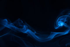 Blue smoke on black background. Blue white smoke on black background stock images