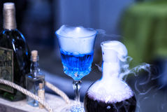 Blue smoke bottle containing witches brew, mana replenishment.  royalty free stock photography