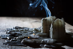 Blue smoke with candls. On old wooden shelf Stock Images