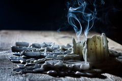 Blue smoke with candls on wooden shelf Royalty Free Stock Image