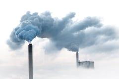 Blue smoke from chimneys Stock Image