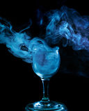 Blue smoke in the glass. Halloween. Royalty Free Stock Image