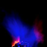 Blue smoke haze. Blue and pink coloured smoke drifting over a fire Stock Photos
