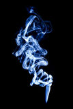 Blue smoke isolated on black Stock Image