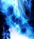 Blue Smoke. Isolated on black background Stock Photos