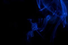 Blue smoke movement background. Blue smoke on black background Stock Image
