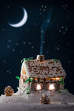 Blue smoke poured out of the gingerbread home stock photography