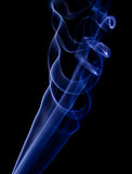 Blue smoke rings #1. Elegant blue smoke with a black background Stock Images