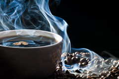 Blue smoke and roasted coffee Royalty Free Stock Images