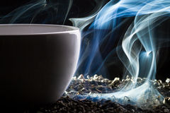 Blue smoke and roasted tea Stock Image