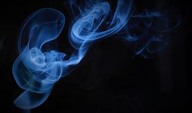 Blue smoke. Smoking and flume Stock Image