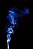 Blue smoke. Spiral form. On a black background Stock Photos