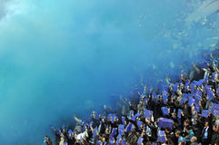 Blue smoke in the stands of the fans Royalty Free Stock Images