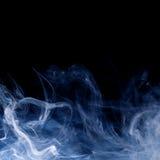 Blue smoke swirls over black. Background Stock Image